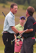 2006 Tournament of Champions winner Michael Harris from Milwaukee, Wisconsin (left) shakes hands with final round playing partner John DalCorobbo (right) as his wife and caddie Jennifer Harris (center) looks on after winning the 2006 Tournament of Champions at Boyne Mountain.