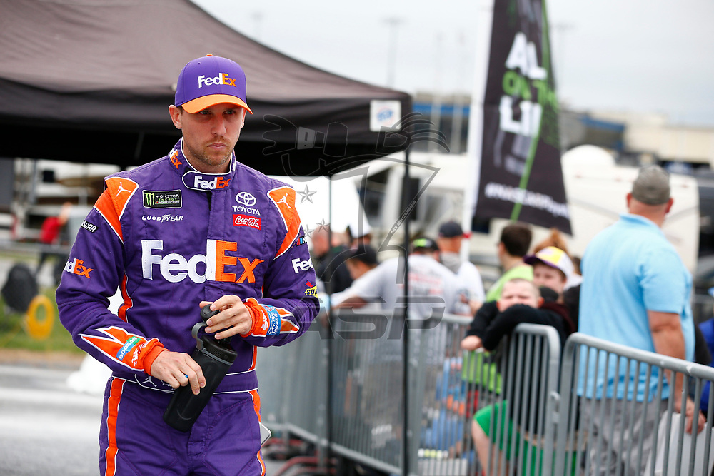 Denny Hamlin (11) hangs out in the garage during practice for the Gander Outdoors 400 at Dover International Speedway in Dover, Delaware.