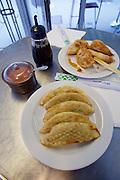 Vienna, Austria. Rochusmarkt. Mandu & Co. Deep fried Mandus with meat (backgr.) and vegetables.