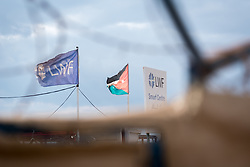 20 February 2020, Za'atari Camp, Jordan: Flags wave by the Lutheran World Federation's Peace Oasis and Smurf Centre.