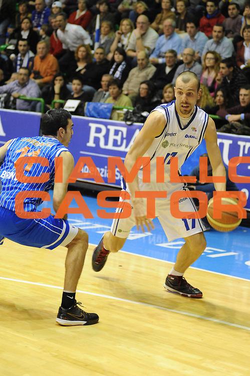 DESCRIZIONE : Sassari Lega A2 2009-10 Final Four Coppa Italia Semifinale Banco di Sardegna Sassari Enel Brindisi<br /> GIOCATORE : Francesco Conti<br /> SQUADRA : Banco di Sardegna Sassari<br /> EVENTO : Campionato Lega A2 2009-2010<br /> GARA : Banco di Sardegna Sassari Enel Brindisi<br /> DATA : 06/03/2010<br /> CATEGORIA : Palleggio<br /> SPORT : Pallacanestro<br /> AUTORE : Agenzia Ciamillo-Castoria/GiulioCiamillo<br /> Galleria : Lega Basket A2 2009-2010  <br /> Fotonotizia : Sassari Lega A2 2009-2010 Final Four Coppa Italia Semifinale Banco di Sardegna Sassari Enel Brindisi<br /> Predefinita :
