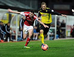 Watford's Joel Ekstrand challenges for the ball with Bristol City's Brendan Moloney - Photo mandatory by-line: Dougie Allward/JMP - Tel: Mobile: 07966 386802 14/01/2014 - SPORT - FOOTBALL - Vicarage Road - Watford - Watford v Bristol City - FA Cup - Third Round - replay