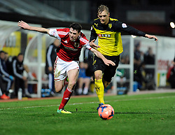 Watford's Joel Ekstrand challenges for the ball with Bristol City's Brendan Moloney - Photo mandatory by-line: Dougie Allward/JMP - Tel: Mobile: 07966 386802 14/01/2014 - SPORT - FOOTBALL - Vicarage Road - Watford - Watford v Bristol City - FA Cup - Third Round - replay