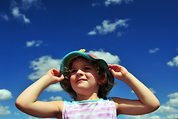 &copy; Licensed to London News Pictures. 31/07/2018<br /> LEEDS, UK.<br /> This little girl enjoying a blue sky day at Leeds Castle with her sun hat on.<br /> Blue sky and sunny weather at Leeds castle in Kent.<br /> (permission given)<br /> Photo credit: Grant Falvey/LNP