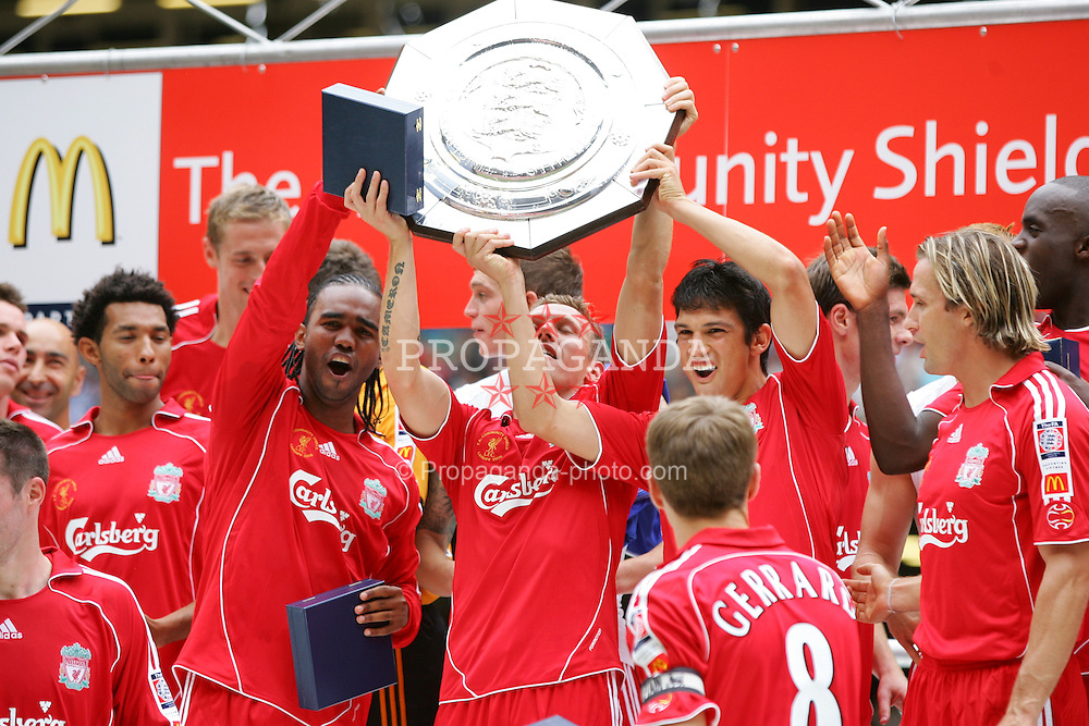 CARDIFF, WALES - SUNDAY, AUGUST 13th, 2006: Liverpool's Florent Sinama-Pongolle, Craig Bellamy and Mark Gonzalez lift up the trophy after the Community Shield match against Chelsea at the Millennium Stadium. (Pic by David Rawcliffe/Propaganda)