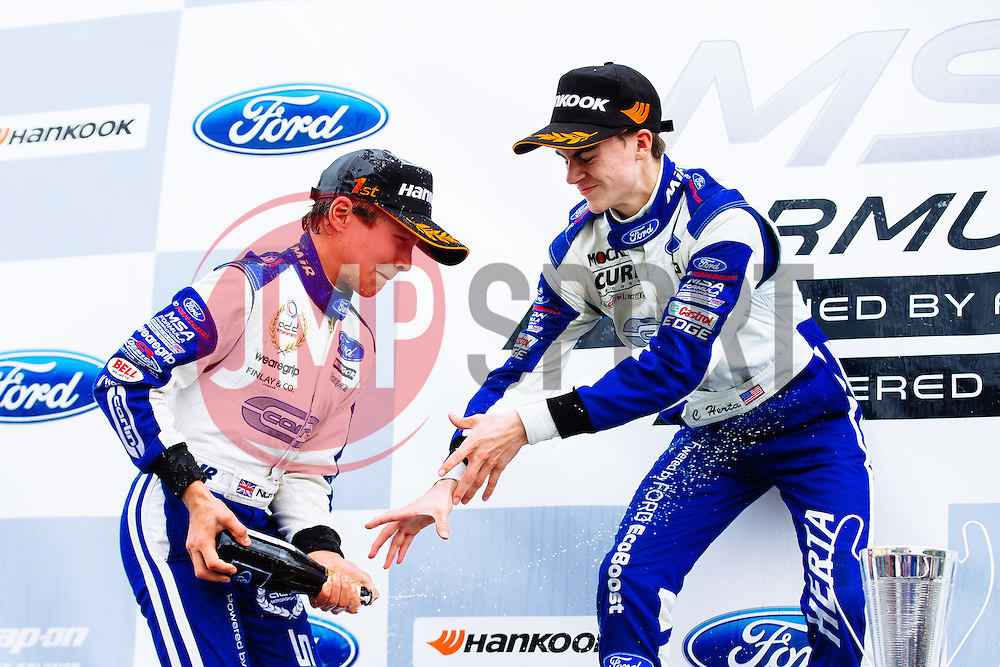Lando Norris sprays the Champagne after he takes the Win in his first race of the weekend (joined on the podium by his 2nd placed teammate Colton Herta)   #31 Carlin   MSA Formula Championship   Race 1 - Mandatory byline: Rogan Thomson/JMP - 07966 386802 - 10/10/2015 - MOTORSPORT - Brands Hatch GP Circuit - Fawkham, England - BTCC Meeting Day 1.