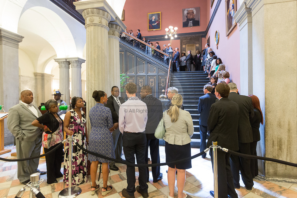 Mourners wait in line to pay respects to slain State Senator Clementa Pinckney in the State House June 24, 2015 in Columbia, South Carolina. Pinckney is one of the nine people killed in last weeks Charleston church massacre.