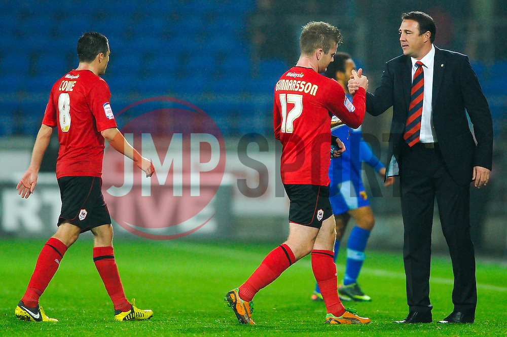 Winning goal scorer Cardiff Midfielder Aron Gunnarsson (ISL) is congratulated by Manager Malky Mackay (SCO) after the match - Photo mandatory by-line: Rogan Thomson/JMP - Tel: Mobile: 07966 386802 23/10/2012 - SPORT - FOOTBALL - Cardiff City Stadium - Cardiff. Cardiff City v Watford - Football League Championship