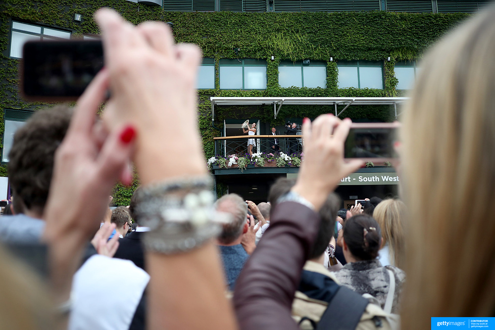 LONDON, ENGLAND - JULY 15:  Garbine Muguruza of Spain shows her winner trophy to the crowd on the balcony of Centre court after her victory against against Venus Williams of The United States in the Wimbledon Lawn Tennis Championships at the All England Lawn Tennis and Croquet Club at Wimbledon on July 15, 2017 in London, England. (Photo by Tim Clayton/Corbis via Getty Images)