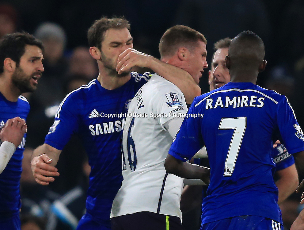 11 February 2015 - Barclays Premier League - Chelsea v Everton - Branislav Ivanovic of Chelsea wraps his arm around the throat of James McCarthy of Everton - Photo: Marc Atkins / Offside.
