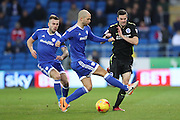 Cardiff City defender Matthew Connolly (16) fouls Brighton & Hove Albion winger Jamie Murphy (15) during the EFL Sky Bet Championship match between Cardiff City and Brighton and Hove Albion at the Cardiff City Stadium, Cardiff, Wales on 3 December 2016.