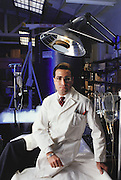 Cryonics: Dr Avi Ben-Abraham, of Trans Time Inc., a cryonics company of Oakland, California. Cryonics is a speculative life support technology that seeks to preserve human life in a state that will be viable and treatable by future medicine. Cryonics involves the freezing of whole human bodies, organs or pet cats & dogs, and their preservation in liquid nitrogen (background) to await a future thaw. Cryonicists claim that medical science in the future may offer a cure for cancer or the restoration of youth, and that their methods of preservation might offer some people an opportunity to benefit from these advances. Conventional cryobiology methods for freezing organs (for organ transplants, for example) are plagued by problems of intracellular ice crystal formation, which destroys their component cells. Dr. Ben Abraham wears a bracelet that identifies him as a cryonic patient should he be found dead. MODEL RELEASED 1987..