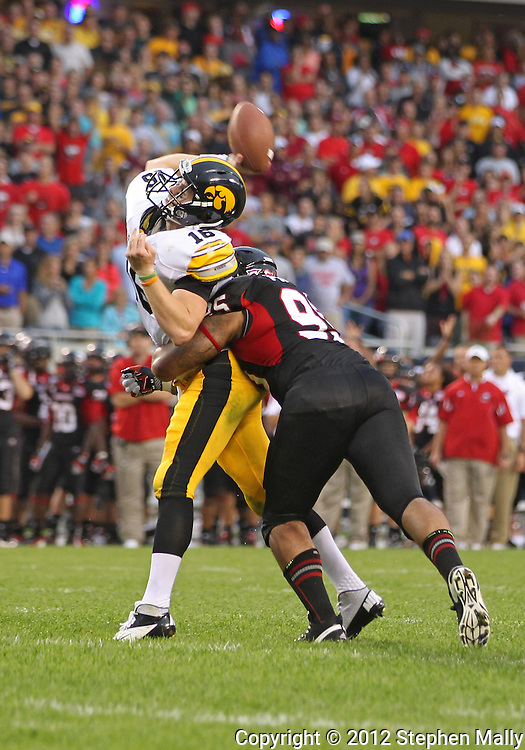 September 01 2012: Iowa Hawkeyes quarterback James Vandenberg (16) is hit by Northern Illinois Huskies defensive end Sean Progar (95) as he throws during a two point conversion attempt during the second half of the NCAA football game between the Iowa Hawkeyes and the Northern Illinois Huskies at Soldiers Field in Chicago, Illinois on Saturday September 1, 2012. Iowa defeated Northern Illinois 18-17.