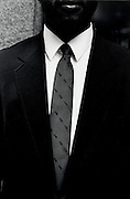 Close up of a man wearing a suit and tie