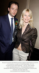 Model CLAUDIA SCHIFFER and her husband MATTHEW VAUGHAN at a party to celebrate St.George's day held at Mel's, 1 Dover Street, London W1 in conjunction with Krug champagne and the Spy diary on The Daily Telegraph on 23rd April 2003.