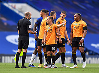 Football - 2019 / 2020 Premier League - Chelsea vs. Wolverhampton Wanderers<br /> <br /> Wolverhampton Wanderers' Daniel Podence speaks to Referee Stuart Attwell after their 2-0 defeat, at Stamford Bridge.<br /> <br /> COLORSPORT/ASHLEY WESTERN
