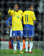 Ronaldinho and Robinho prepare to defend a free kick during the International Friendly match between Brazil and Italy at the Emirates Stadium on February 10, 2009 in London, England.