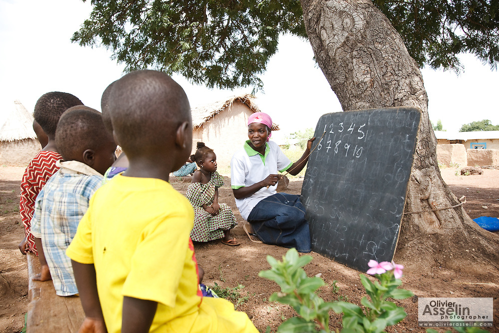 Abdulai Sadia teaches children under a tree in the community of Kunayili, near Gushegu, Northern Ghana, on Wednesday November 2, 2011. Sadia first started teaching children under a tree before community members helped her build a proper school.