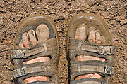 A pair of muddy feet at the 2005 Glastonbury festival.