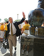 August 31 2013: Iowa Hawkeyes head coach Kirk Ferentz walks in past the statue of Nile Kinnick before the start of the NCAA football game between the Northern Illinois Huskies and the Iowa Hawkeyes at Kinnick Stadium in Iowa City, Iowa on August 31, 2013. Northern Illinois defeated Iowa 30-27.