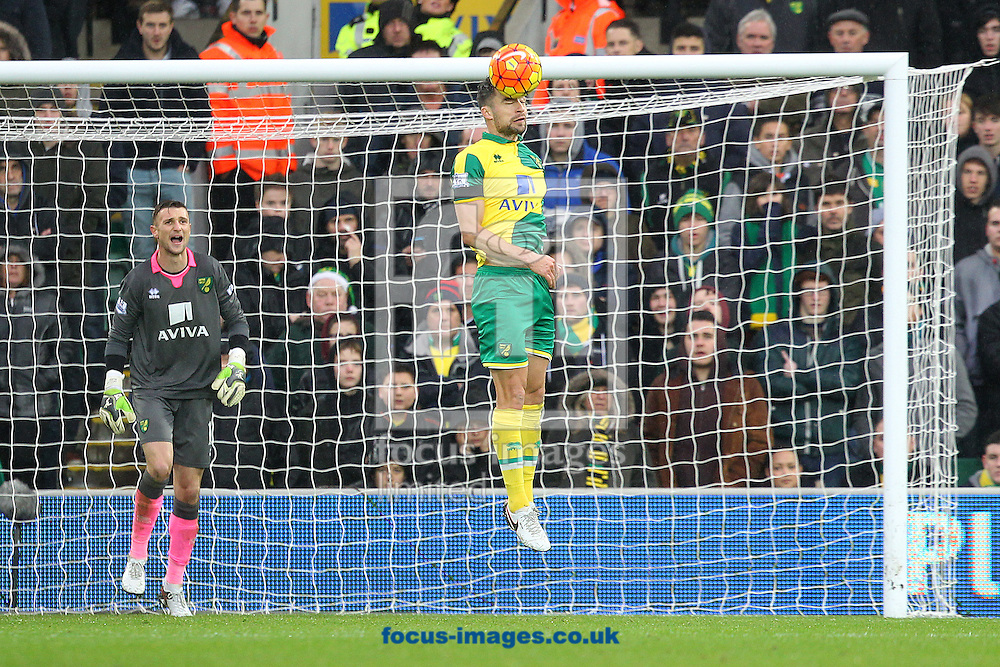 Russell Martin of Norwich heads clear during the Barclays Premier League match at Carrow Road, Norwich<br /> Picture by Paul Chesterton/Focus Images Ltd +44 7904 640267<br /> 12/12/2015