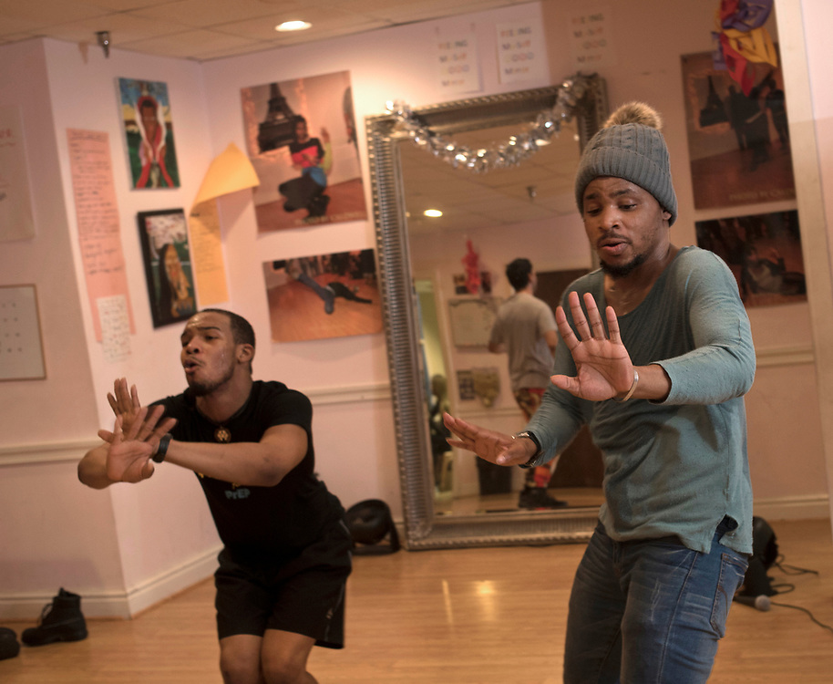 Roi Johnson (left) and Tyreese Taylor  (right) dance together during a weekly vogue workshop at Project Silk in downtown Pittsburgh.