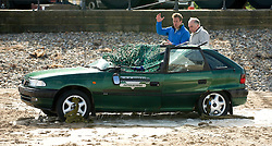 © Licensed to London News Pictures. 19/03/2012..Saltburn, England..Presenter Ben Fogle was on Saltburn beach today taking part in the filming and production of a new 4 part documentary from Sky TV and National Geographic Channel showcasing the darker side of Mother Nature. ..The effects of a Tsunami wave hitting the coast were recreated on Saltburn beach and the damage caused to a vehicle by the power of water was demonstrated by dropping around a tonne of water from a crane onto the vehicle which had been placed on the beach close to the pier...Filming in the town is expected to take around two days and the four-part Storm City series, which will air in the summer, has been filmed on locations throughout the world and sets in Canada and the UK...Photo credit : Ian Forsyth/LNP