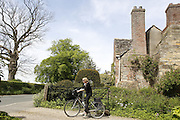 A tourist is exiting Shandy Hall, in Coxwold, Yorkshire, England, United Kingdom.