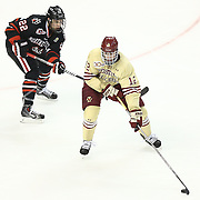 Kevin Hayes #12 of the Boston College Eagles keeps the puck from Tanner Pond #22 of the Northeastern Huskies during The Beanpot Championship Game at TD Garden on February 10, 2014 in Boston, Massachusetts. (Photo by Elan Kawesch)