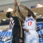 Erie BayHawks Guard Mustafa Shakur (22) blocks Delaware 87ers Guard Lorenzo Brown (17) shot as Brown drives towards the basket in the second half of a NBA D-league regular season basketball game between Delaware 87ers (76ers) and the Erie BayHawks (Knicks) Friday, Jan. 3, 2014 at The Bob Carpenter Sports Convocation Center, Newark, DE