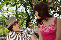Young Couple Sitting in a Park