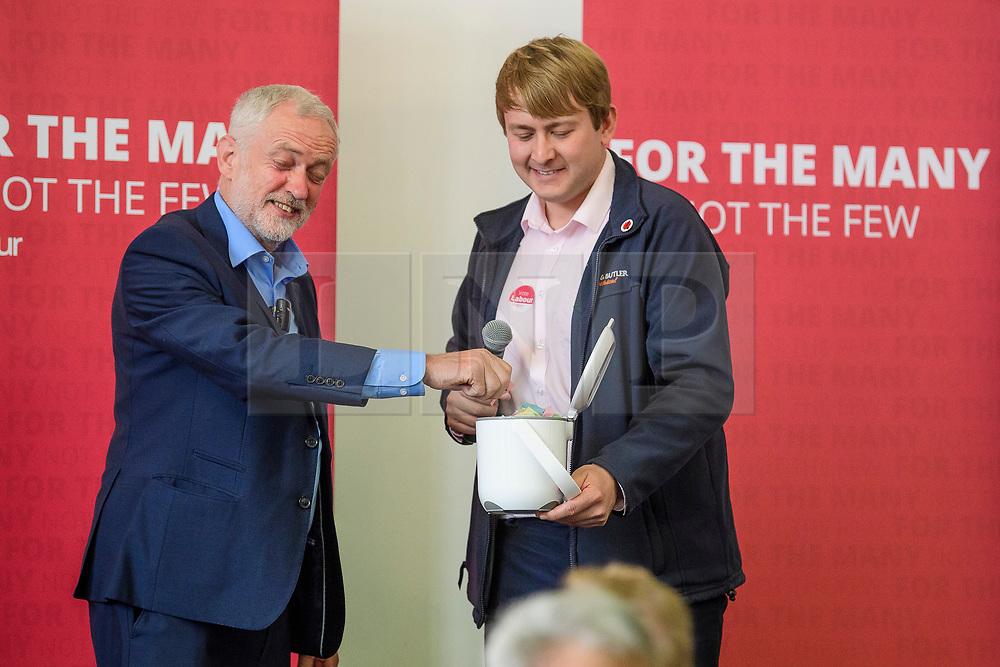 © Licensed to London News Pictures. 07/08/2017. Crawley, UK. Labour Party leader JEREMY COBYN draws the raffle at the end of a campaign visit in Crawley, Surrey. Corbyn has faced recent criticisms for his response to the crisis in Venezuela, a country ruled by a government he has openly backed in the past.  Photo credit: Ben Cawthra/LNP