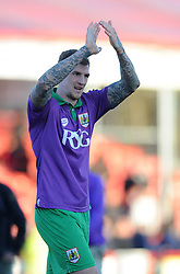 Bristol City's Aden Flint celebrates the 1-2 win over Crawley - Photo mandatory by-line: Dougie Allward/JMP - Mobile: 07966 386802 - 07/03/2015 - SPORT - Football - Crawley - Broadfield Stadium - Crawley Town v Bristol City - Sky Bet League One