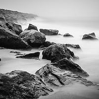 Newport Beach California Wedge black and white photo. The Wedge is a famous surfing spot known for its rock jetty.