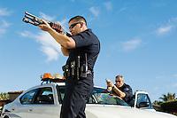 Police Officer Aiming Shotgun