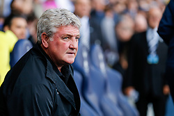 Hull City Manager Steve Bruce looks on sternly as he takes his seat in the dugout before the match - Photo mandatory by-line: Rogan Thomson/JMP - 07966 386802 - 16/05/2015 - SPORT - FOOTBALL - London, England - White Hart Lane - Tottenham Hotspur v Hull City - Barclays Premier League.