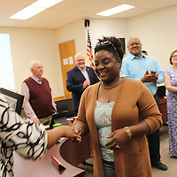RAY VAN DUSEN/BUY AT PHOTOS.MONROECOUNTYJOURNAL.COM<br /> Aberdeen School District Academics and Planning Director Temeka Shannon, left, congratulates Belle-Shivers Middle School and district parent of the year, China Johnson, during last week's school board meeting. Also recognized were Aberdeen High School parent of the year Dennis McNairy, Sr. and Aberdeen Elementary School parent of the year Ashley Forrester.