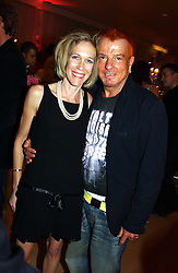 EVA RAUSING and NICKY HASLAM at a party at The Sanderson Hotel, Bernnnnners Street, London in aid of Sargent Cancer Care for Children on 7th July 2004.