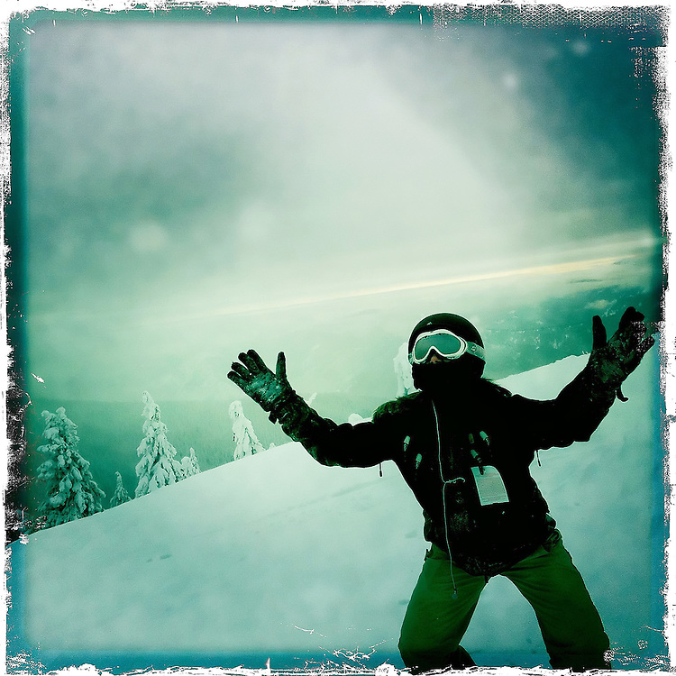 """Felicia Pollos doing her """"wookie"""" dance on top of Kellogg Peak at Silver Mountain during a snowboarding trip on Sunday, Jan. 2, 2011."""