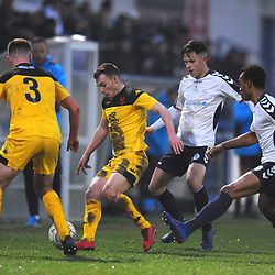 TELFORD COPYRIGHT MIKE SHERIDAN 19/1/2019 - Sam Austin (formerly of AFC Telford) holds off Ryan Barnett of AFC Telford (on loan from Shrewsbury Town Football Club) and Marcus Dinanga during the Vanarama Conference North fixture between AFC Telford United and Kidderminster Harriers