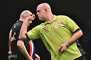 Michael van Gerwen and Raymond van Barneveld  during the Betway Premier League Darts at the Manchester Arena, Manchester, United Kingdom on 23 March 2017. Photo by Mark Pollitt.