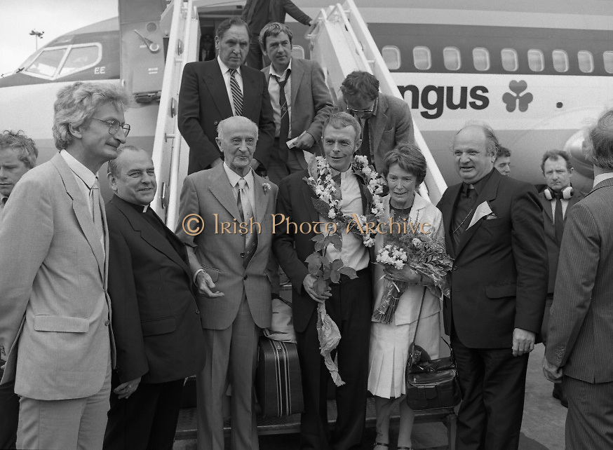 """Fr Niall O'Brien Returns from Captivity.1984..14.07.1984..07.14.1984..On 6 May 1983,Fr Niall O'Brien was arrested along with two other priests, Fr. Brian Gore, an Australian, Fr. Vicente Dangan, a Filipino and six lay workers - the so-called """"Negros Nine"""", for the murders of Mayor Pablo Sola of Kabankalan and four companions. The priests where held under house arrest for eight months but """"escaped"""" to prison in Bacolod City, the provincial capital, where they felt they would be safer.The case received widespread publicity in Ireland and Australia, the home of one of the co-accused priests, Fr. Brian Gore. When Ronald Reagan visited Ireland in 1984, he was asked on Irish TV how he could help the missionary priest's situation. A phone call the next day from the Reagan administration to Ferdinand Marcos resulted in Marcos offering a pardon to Fr. O'Brien and his co-accused..(Ref Wikipedia)...Picture shows Fr Niall O'Brien with his parents Mr and Mrs O'Brien and Cardinal Tomas O Fiach as he descended the aircraft stairs at Dublin Airport. Also included is Mr Jim O'Keefe TD,Minister of State at the Dept of Foreign Affairs and Bishop Eamon Casey."""