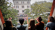 Spectators wave at a float during the 194-year-old Savannah St. Patrick's Day parade, Saturday, March 17, 2018, during the St. Patrick's Day parade in Savannah, Ga. (AP Photo/Stephen B. Morton)