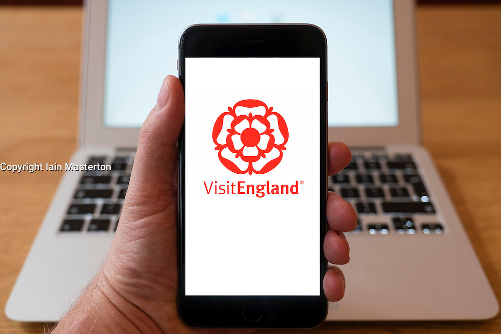Using iPhone smartphone to display logo of Visit England tourist organisation.