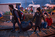 March 4, 2016 - Idomeni, Greece:  Refugees from Syria  arrive late at night after an long walk in the make shift camp at the Idomeni border crossing in Greece. 12,000 refugees are stuck here after Macedonia closed the border. New arrivals come in every day, making living conditions more and more difficult. (Steven Wassenaar/Polaris)