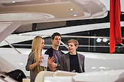 Hostesses in grey welcome potential clients. The Sunseeker stand includes Nicole Scherzinger launching the new Predator 57 with the Sunseeker Founder, Robert Braithwaite. The CWM FX London Boat Show, taking place 09-18 January 2015 at the ExCel Centre, Docklands, London. 09 Jan 2015.