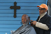 Rick Greer gets his hair cut by Grammy award winning jazz saxophone player Kirk Whalum. Whalum volunteers his time each week, when he is not touring,  to give a shave and a hair cut to homeless men and women in Memphis. Three days per week, the Manna House opens their doors to provide hospitality, showers and clean clothes to the poor and homeless in Memphis.