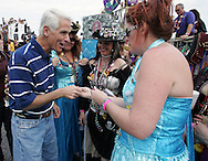 Florida Governor Charlie Crist gets a pin from members of the Krewe of Charlotte de Berry during the 2007 Gasparilla parade in Tampa, Florida.