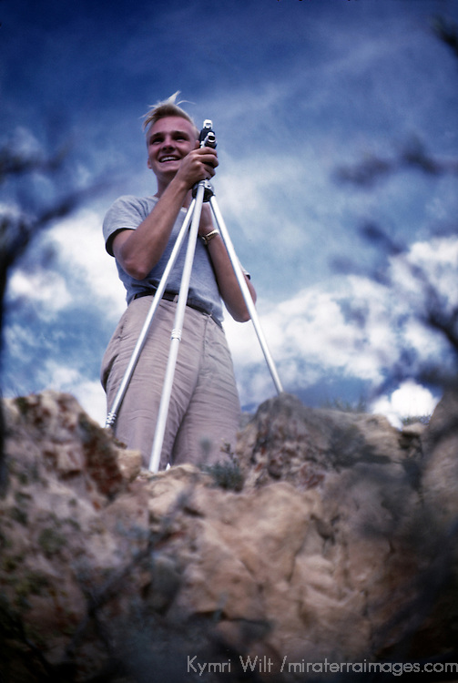 USA, New Mexico. Vintage shot of a man using tripod and camera circa 1950's. Private collection. I inherited this image in a trunk of slides when my father passed away - he was also a photographer and passed his collection on to me.