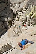 "Conrad Anker climbing ""Fancy Free"" (10b) on ""The Charlatan,"" in The Needles of Southern California."